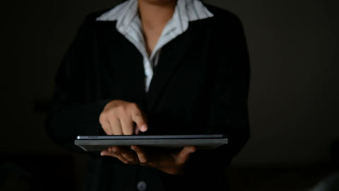 4K Business woman using tablet dark and grain processed GIF
