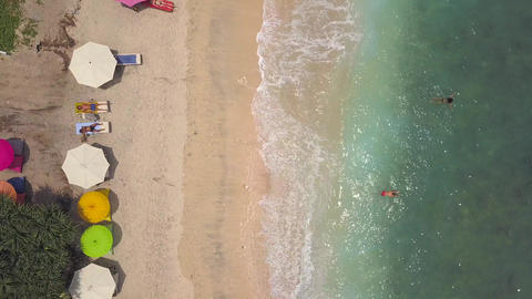 People Relaxing at Sandy Beach on Paradise Tropical Island. Nusa Penida Footage