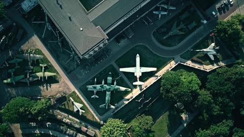Aerial top-down view of military planes and weapons exhibition Footage