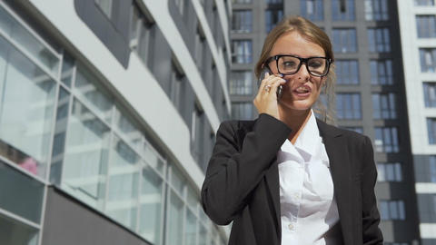 Pretty Businesswoman Talking on Phone Angrily Footage