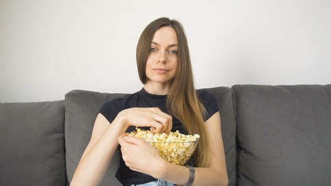 Relaxed Girl Watches Television with Popcorn Live Action