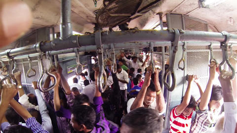 People travel on a busy commuter train in Mumbai Live Action