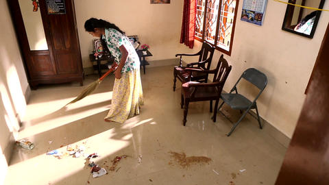 A Woman Doing Chores Cleaning Floor At Home Footage