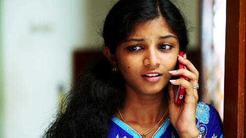Young girl talking on the smart phone and hearing bad news, depression Live Action