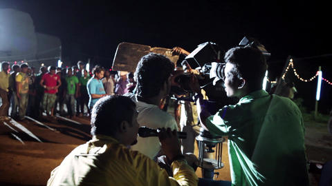 Camera operator working with a cinema broadcast, Cinema Song shooting at night Footage