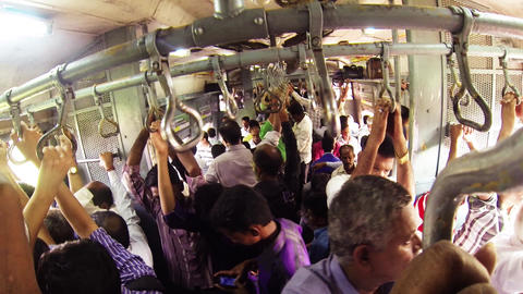 People travel on a busy train in Mumbai Live Action