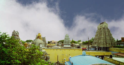 Hindu temple exterior shot, Time lapse - clouds passing over a tower of the Footage