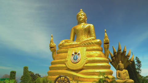 a statue of a golden buddha. Asian religious shrine, travel and tourism Live Action
