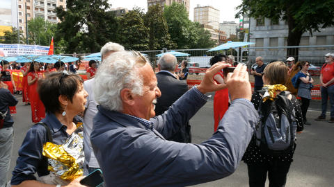 Man takes pictures at demonstration in Milan, Italy Live Action