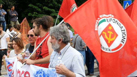 Communist party flags wave during demonstration in Milan, Italy Live Action