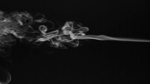 Beautiful twists of white smoke on a black background Stock Video Footage