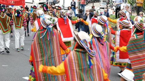 Peruvian dancers in traditional clothing take part to demonstration in Milan, It Live Action