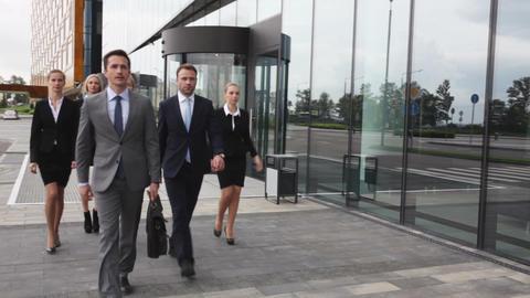 Business people walking outdoors Footage