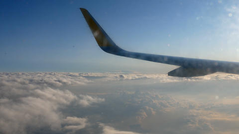 seen from the porthole of an airliner that left from Valencia to Rome early in Footage