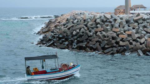 Monastir, Tunisia - 07 June 2018: Fisherman sailing in fishing boat in sea on Footage