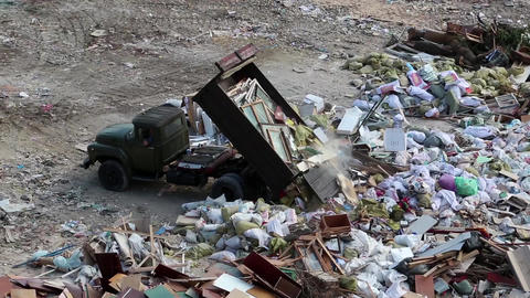 Car unloads garbage in a landfill Footage
