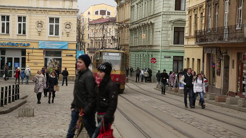 Red tram and people near the Market Square in Lviv, Western Ukraine Footage