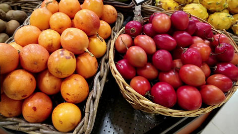 Red and yellow fresh exotic fruits in supermarket Stock Video Footage