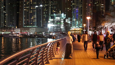 People on the waterfront, night Dubai Marina, United Arab Emirates Footage