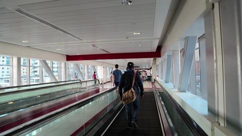 People on travelator inside Dubai metro station, United Arab Emirates Footage