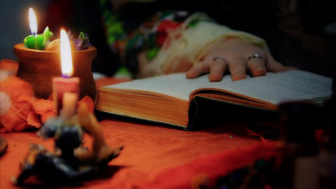 Divination, witch reading spell to luck, magic candles lightning at home Live Action