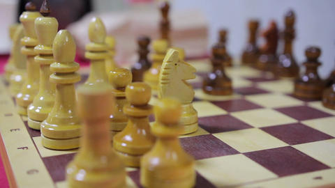 Beautiful wooden chess pieces standing on board, close-up video, hobby Live Action