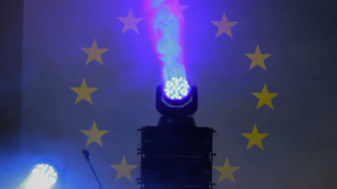 Crossing violet and blue beams of spotlights, LED show, electronic equipment Live Action