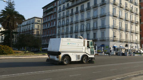 Cleaning truck driving on the road in the Naples city center, transportation Footage