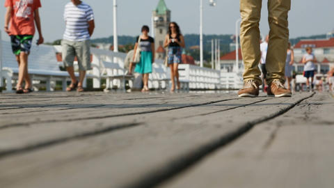 Footsteps of people strolling along old wooden pier, enjoying beauty of sea 影片素材