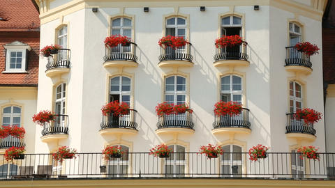 Flowered balconies of elite mansion or luxury hotel, expensive real estate Footage