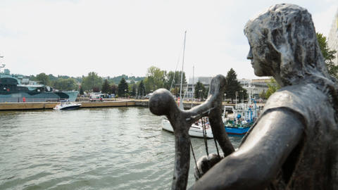 Statue decorating vintage ship leaving port for open sea, entertaining tourists Footage