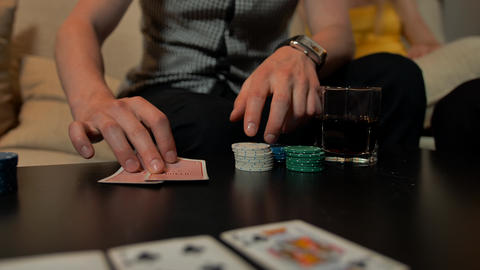 Close up of hands with playing cards and chips on table ビデオ