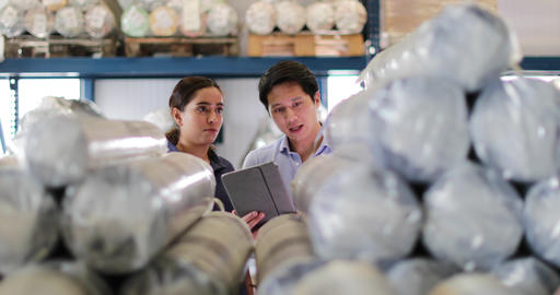 Manager training new employee in a packing warehouse Footage