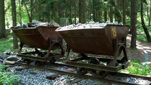 Mining cart with stones. Old and abandoned mining cart in forest Live Action