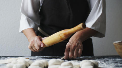 Woman rolling the dough by hands Footage