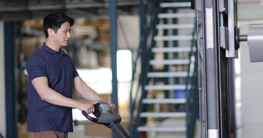 Male working in warehouse using forklift truck Live Action