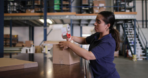 Female working in packing warehouse, Live Action