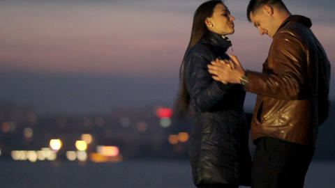 Happy lovers cuddle and dance against the background of a night city. tenderness Live Action