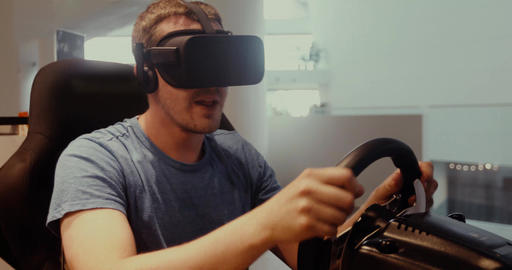 Computer simulation. Man in vr glasses racing steering wheel Footage