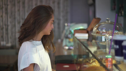 Young Lady Choosing Cake in the Cafe Stock Video Footage