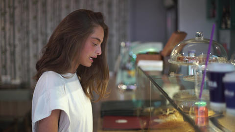 Young Lady Choosing Cake in the Cafe Footage