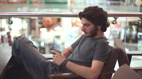 Young Man Sits and Using Phone Stock Video Footage