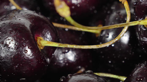 Cherry. Ripe cherries rotating over black background.…, Live Action