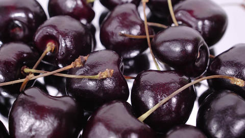 Cherry. Ripe cherries rotating over mirror background. Rotating Black Ripe Sweet Live Action