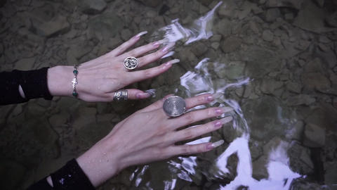 Female hands with long natural nails in the water of mountain creek Footage