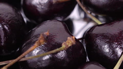 Cherry. Ripe cherries rotating over mirror background. Rotating Black Ripe Sweet Footage
