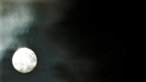 Beautiful and eerie moon and clouds Footage