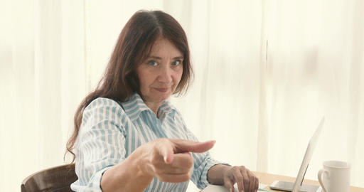 Adult serious woman pointing at camera Footage