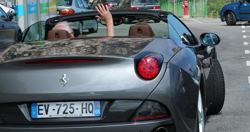 Senior Couple Driving A Luxury Ferrari Convertible Car Footage