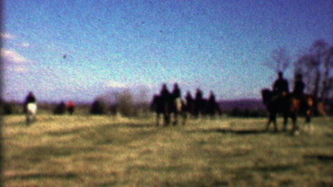 1958: Horse riding fox hunt pack dogs follow red jacket killers Footage